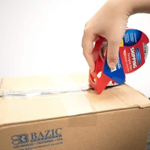 tape with dispenser being used on box