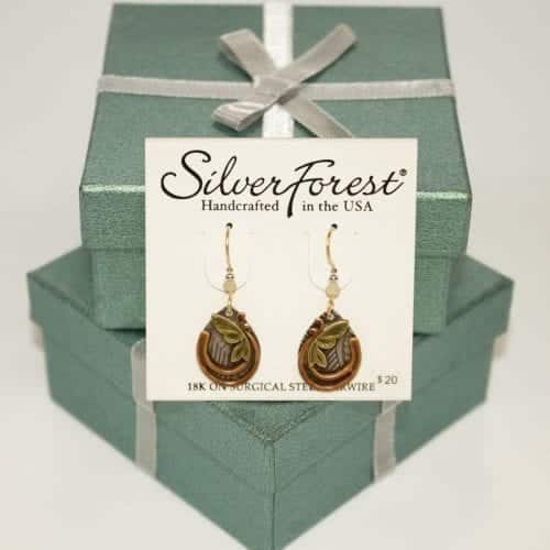 silver forest earrings NE-1314 showing on top of two gift boxes